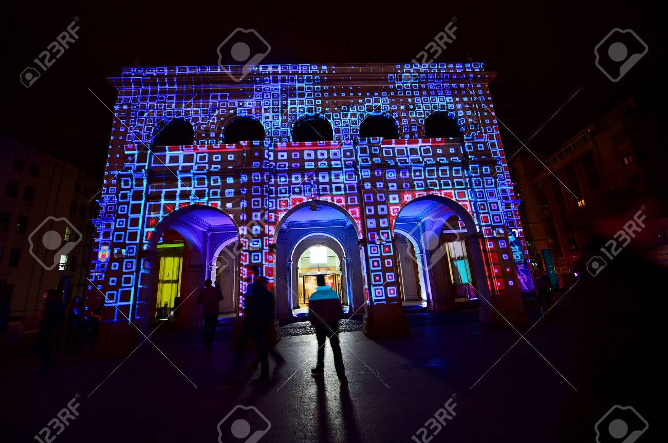 BUCHAREST, ROMANIA - MAY 6: 3D projection mapping are seen on buildings during the Spotlight International Light Festival on May 6, 2016 in Bucharest. - 56160343