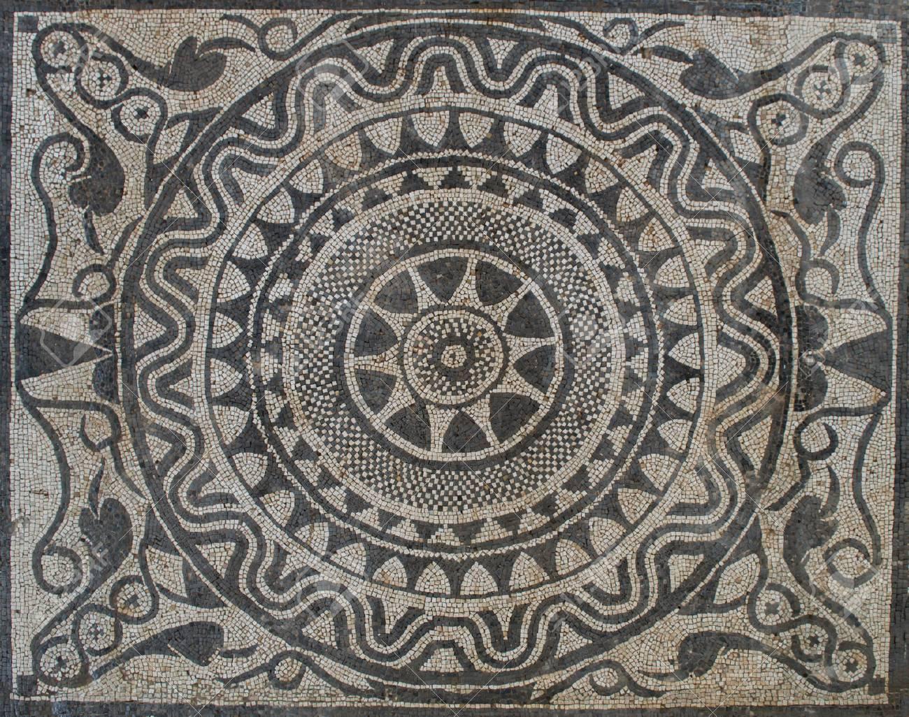 Uprising sun on Mosaic in Roman villa, from II Century B.C. - 56191448