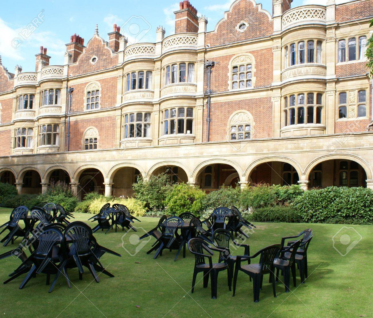 Plastic tables and chairs on the lawn in the courtyard of Sidney Sussex College, Cambridge University Stock Photo - 5860402
