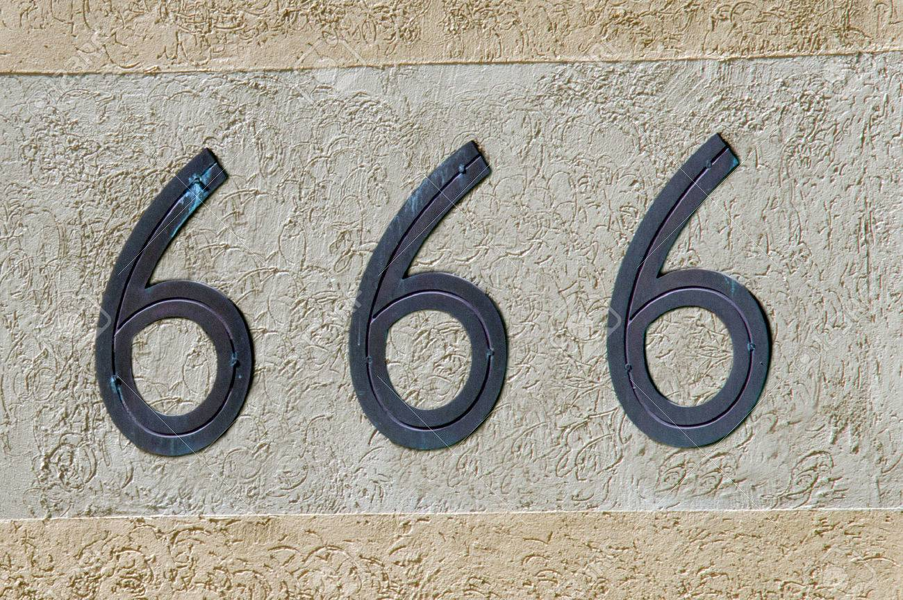 Display Number 666 Sign And Symbol On A Wall Background Concept