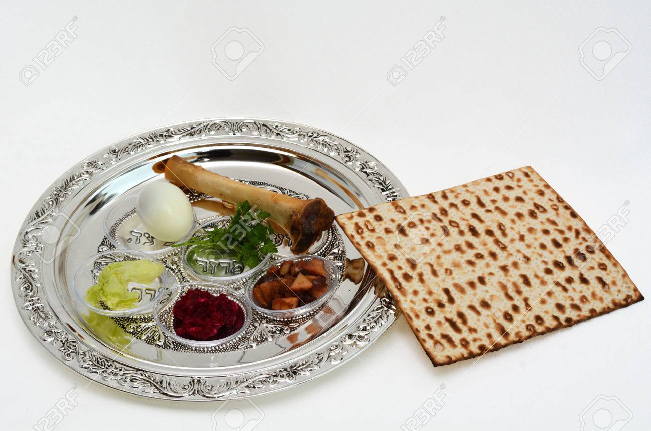 Matzo bread next to Passover Seder Plate with The seventh symbolic item used during the seder meal on passover Jewish holiday. White background with copy space - 47548768