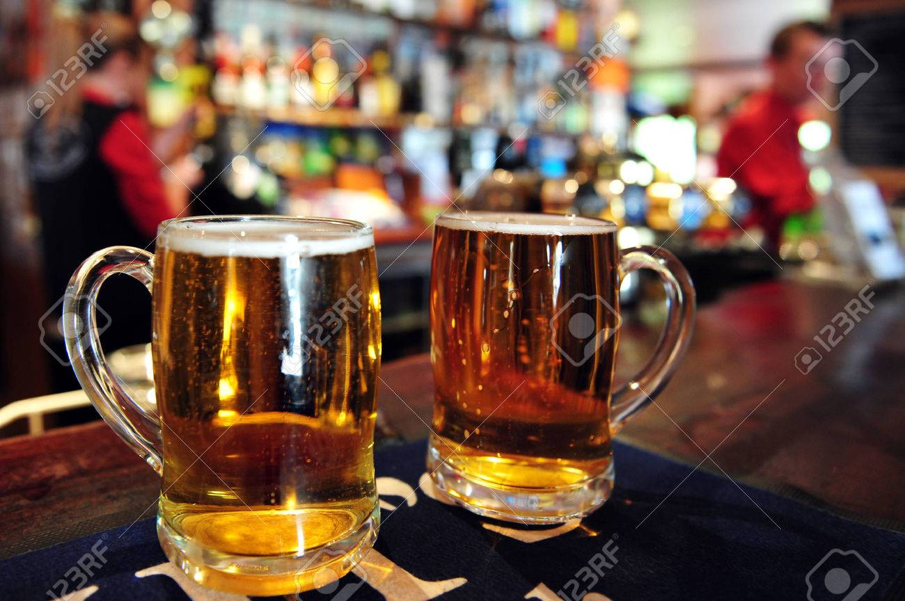Two cups of beer in a pub in New Zealand. - 47613913
