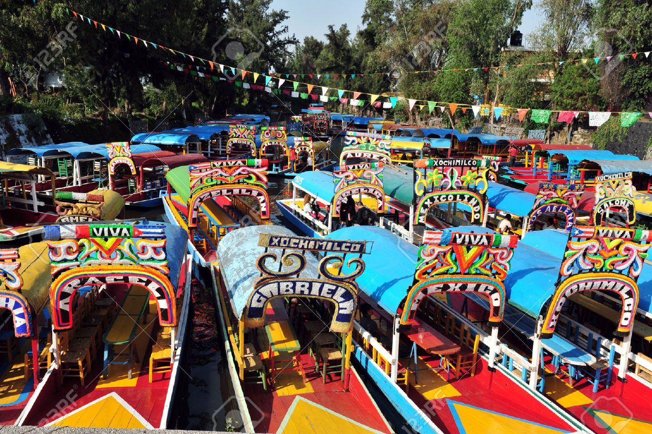 Colourful Mexican gondolas at Xochimilco's Floating Gardens in Mexico City. - 47605163