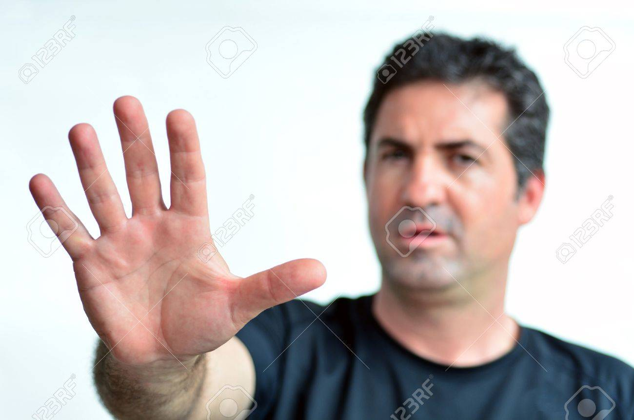 Upset mature man show stop sign with his palm. Copy space on white background.real people.Concept photo of dislike, displeasure,disagreement, disapprove, refusal, refuse, rejection, stop, no, negative - 45808571