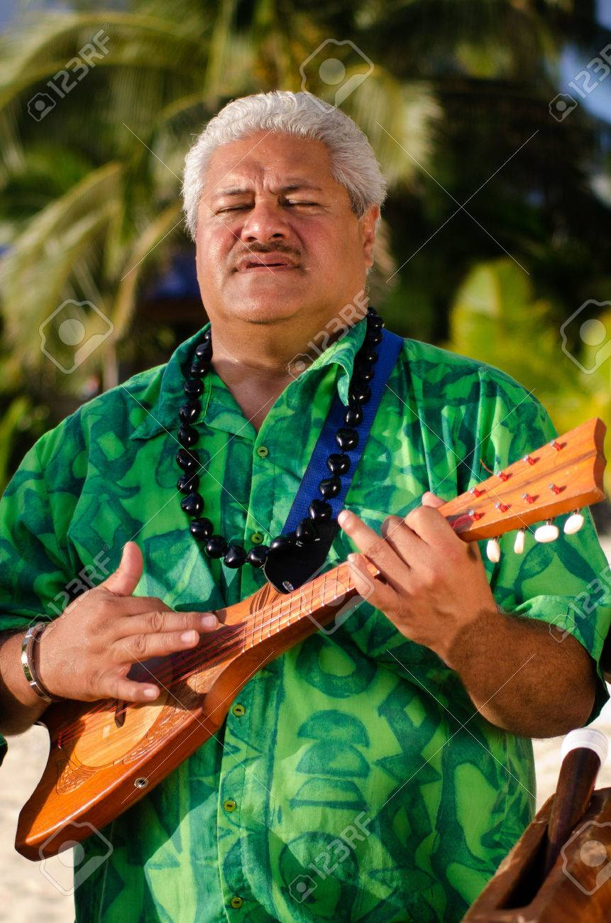 portrait of mature polynesian pacific islanders man sing and.. stock