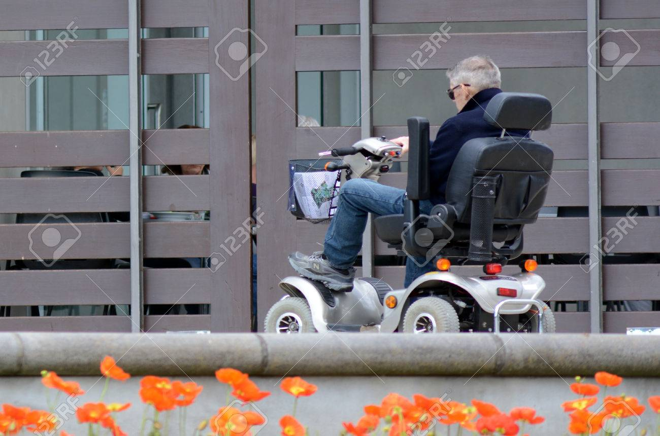 AUCKLAND, NZL - OCT 01 2015:Elderly man drive mobility scooter Currently