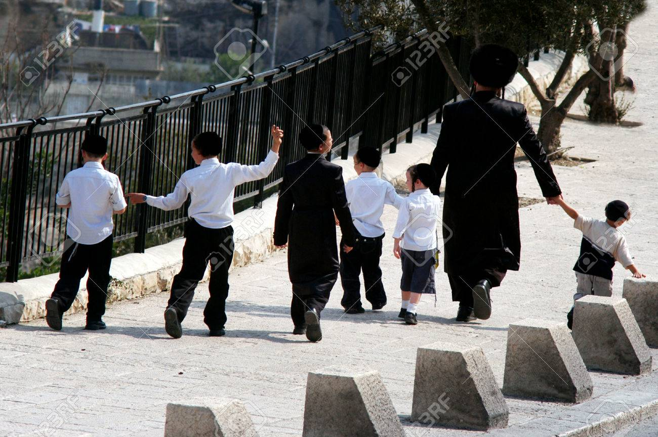 JERUSALEM - OCTOBER 24: An ultra orthodox jewish family walking in the street on October 24 2007 in Jerusalem old city, Israel.An Israel ultra-Orthodox families are producing 5 to 10 children each. - 46309273