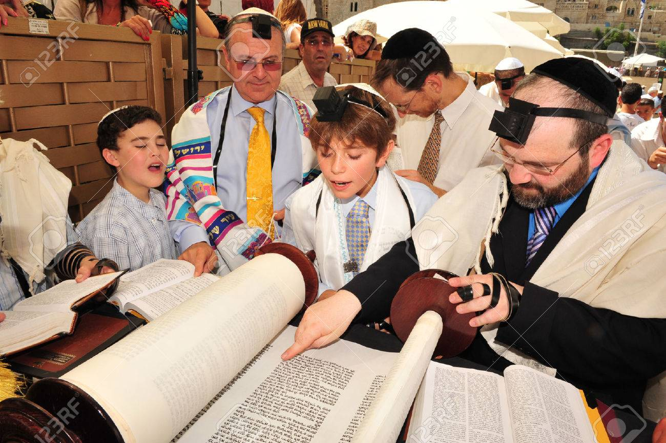 JERUSALEM -SEP 22: Bar Mitzvah ritual at the Wailing wall on September 22 2008 in Jerusalem, Israel.Boy who has become a Bar Mitzvah is morally and ethically responsible for his decisions and actions. - 46436761
