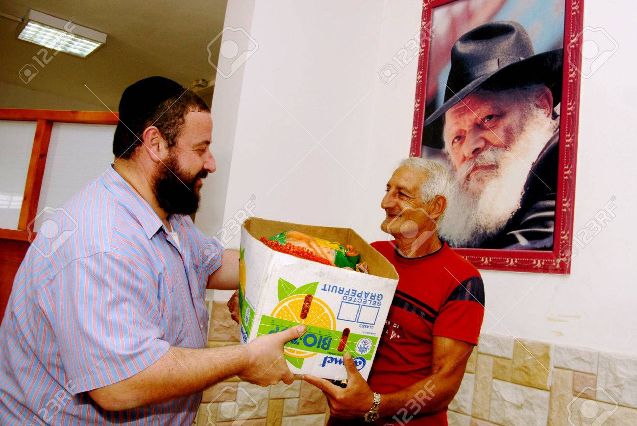 SDEROT - SEPTEMBER 05:Member of Chabad Organization is giving food to poor Jewish families during the jewish holidays on September 05 2007 in Sderot,Israel. - 46437083