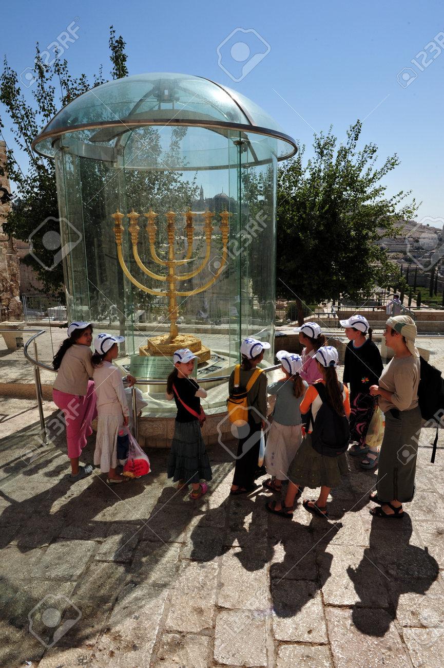 JERUSALEM - JULY 28:Visitors looks at the Jewish Temple Menorah