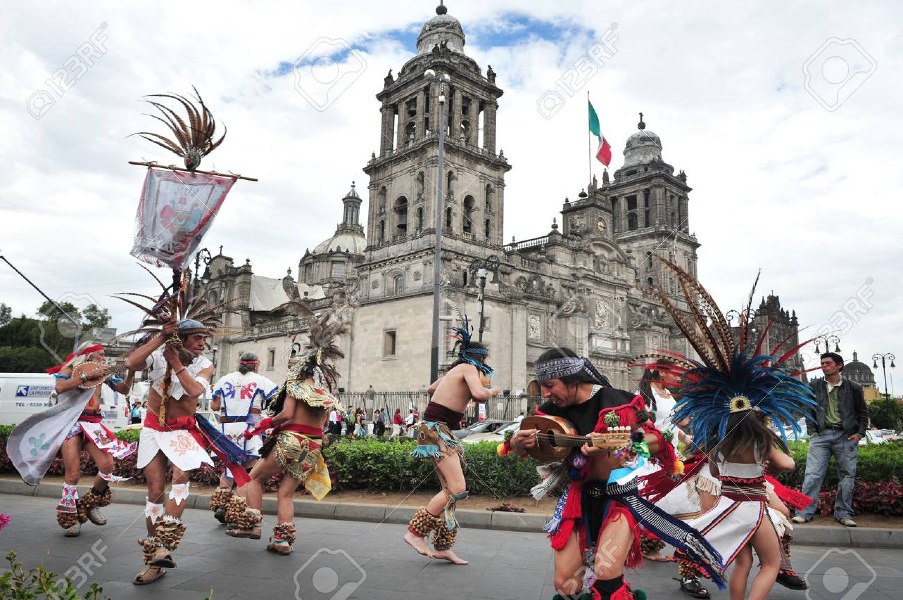MEXICO CITY - FEB 23: Ancient indian folklore outside Catedral Metropolitana on February 23 2010 in Mexico City, Mexico. It's the oldest and largest cathedral in all of Latin America. - 46709862