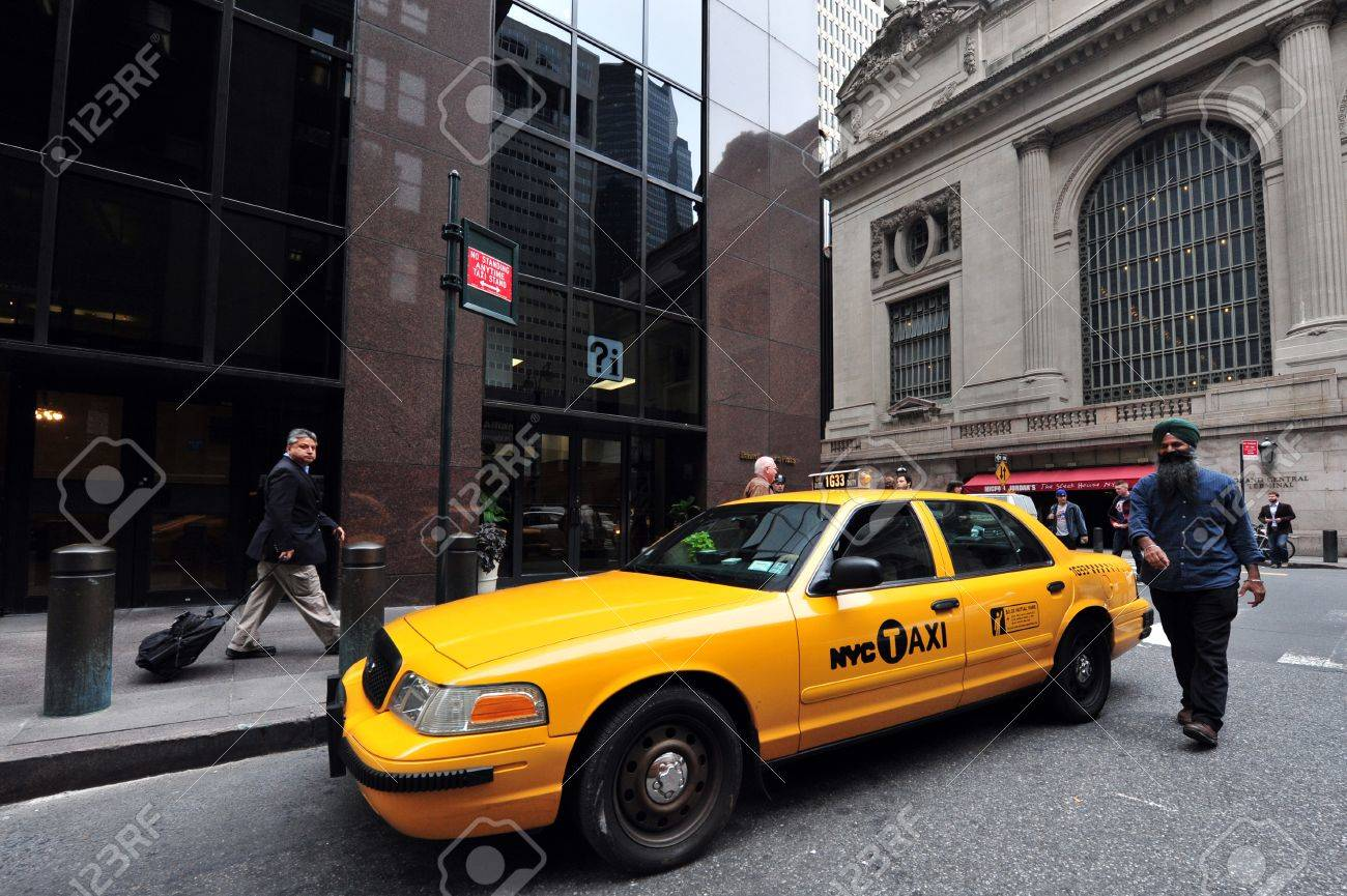 Yellow taxi cab driver, one of the public transportation in Manhattan