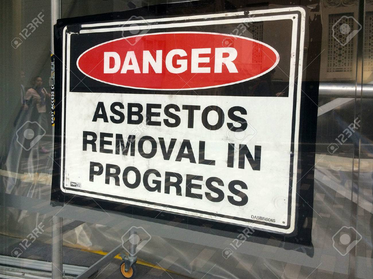 AUCKLAND - AUG 01 2015:Sign reads: Danger - Asbestos removal in progress.Inhalation of asbestos fibers can cause serious and fatal illnesses including lung cancer, mesothelioma and asbestosis. - 47699101