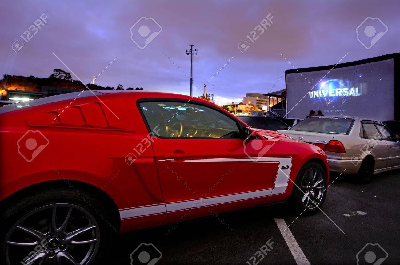 AUCKLAND - NOV 01 2015:Cars in Drive-in theater.Today there is only 400 drive-ins in the United States and 100 exist around the world mainly in Canada and Australia and it becoming popular in China. - 47907359