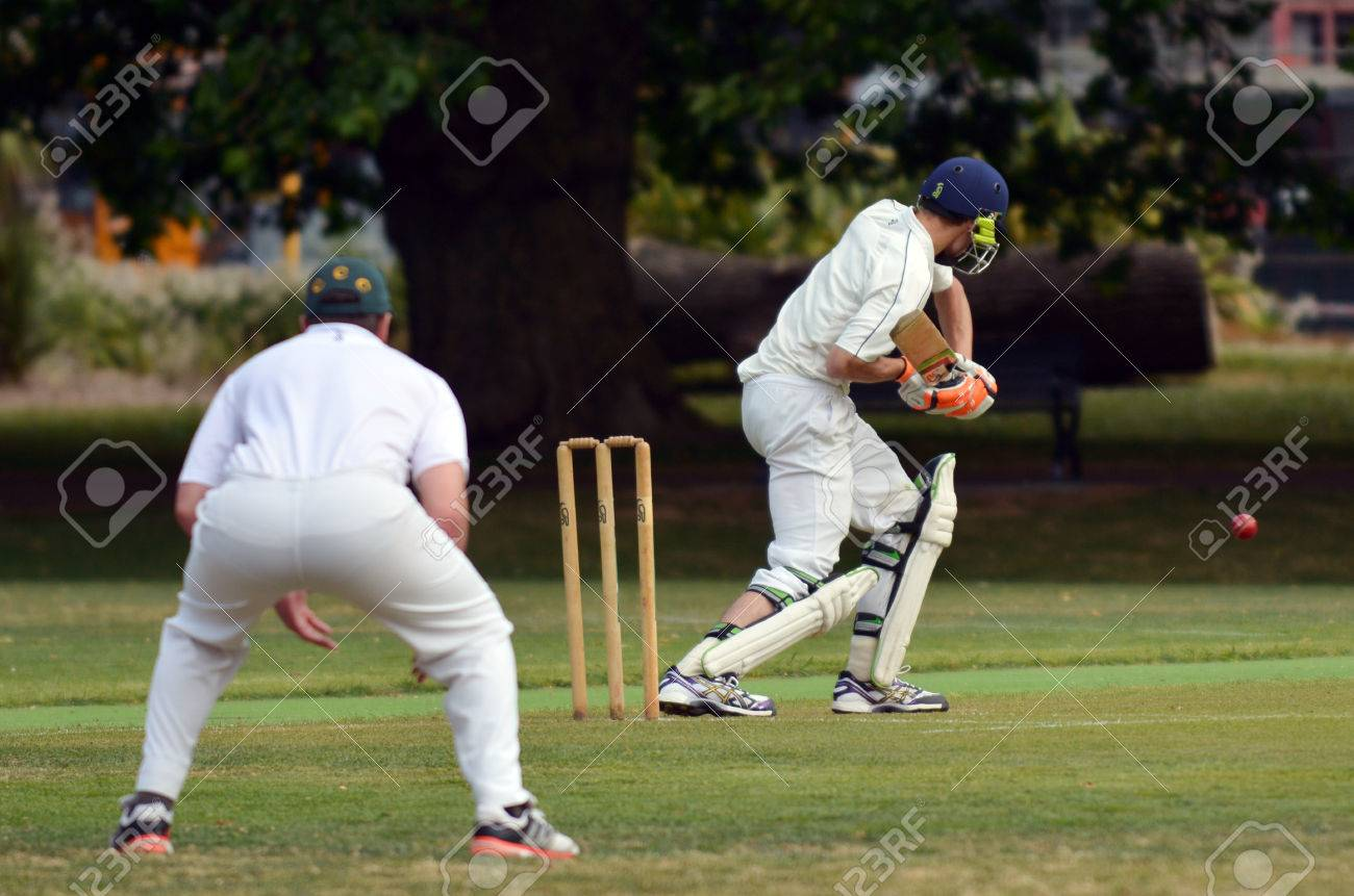 AUCKLAND - NOV 14 2015:Cricket batsman try to blocks the ball. Cricket is played by 120 million players in many countries, making it the world's 2nd most popular sport. - 48528370