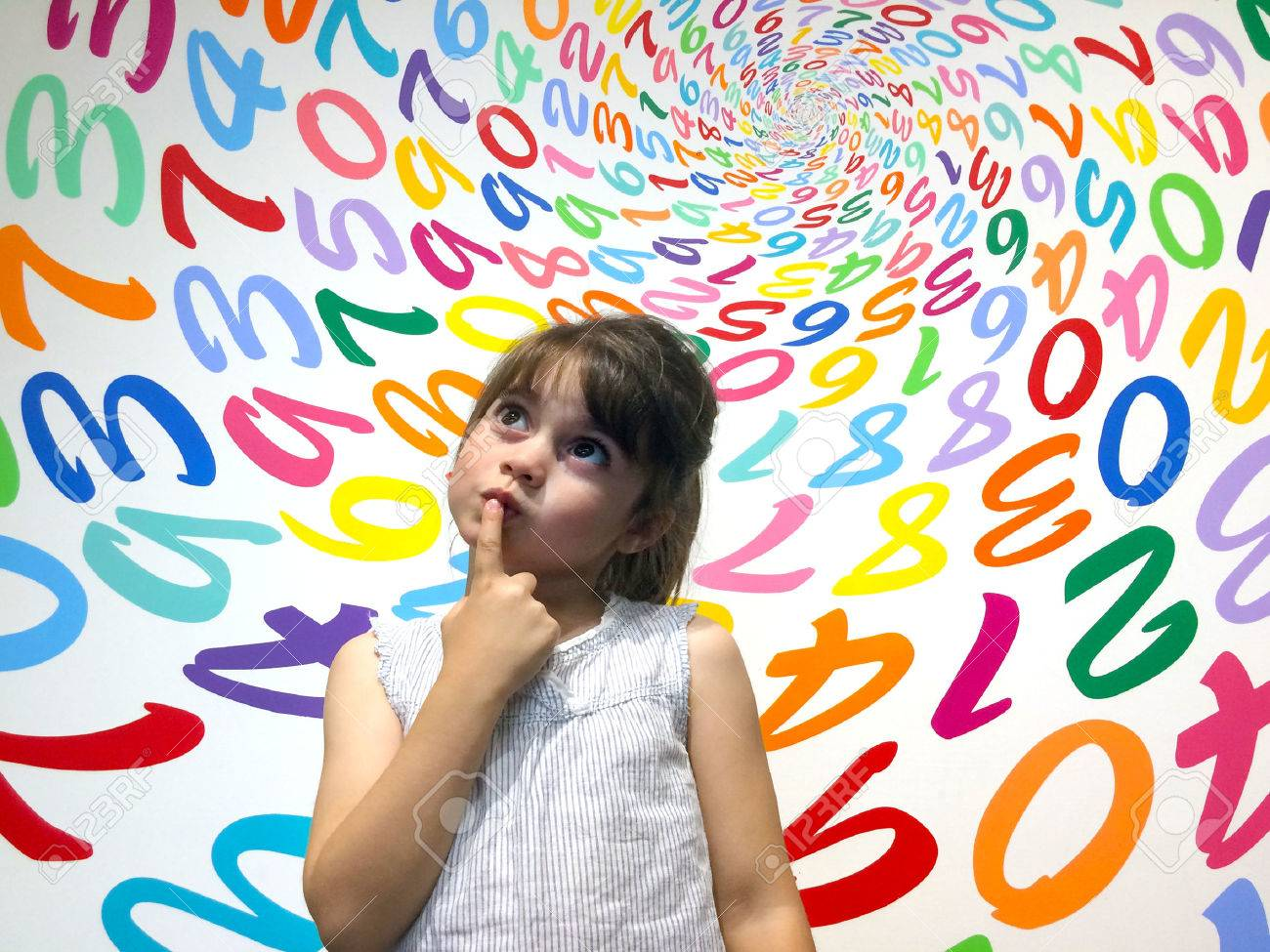 Little girl (age 5-6) do not know how to solve an arithmetic problem. Children education concept - 48521778