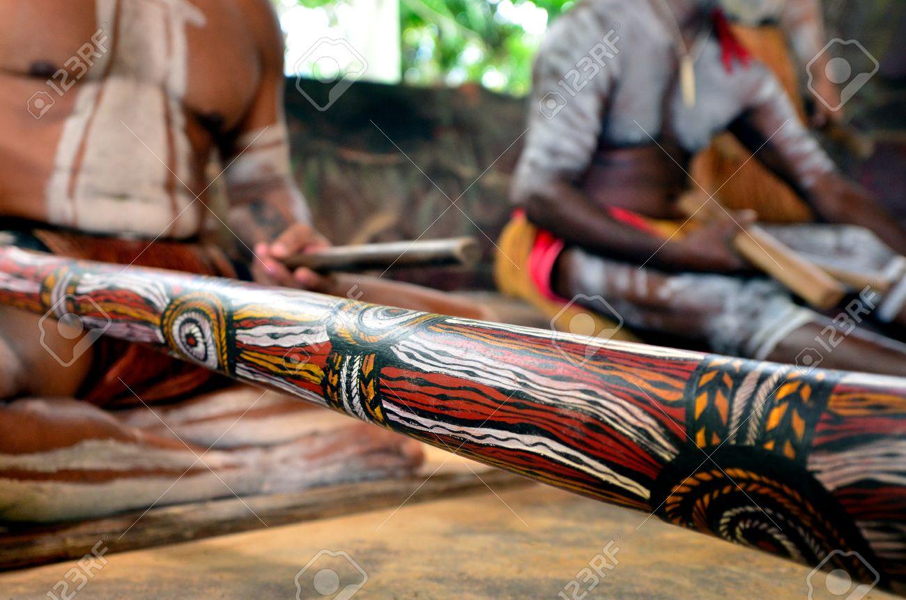 Yirrganydji Aboriginal men play Aboriginal music on didgeridoo and wooden instrument during Aboriginal culture show in Queensland, Australia. - 57327031