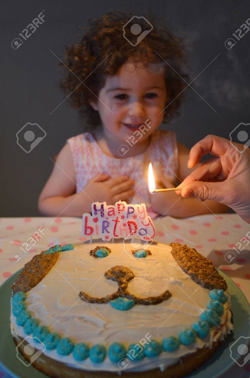 Little Girl Age 2 Having A Birthday Party With Homemade Cake And Candles