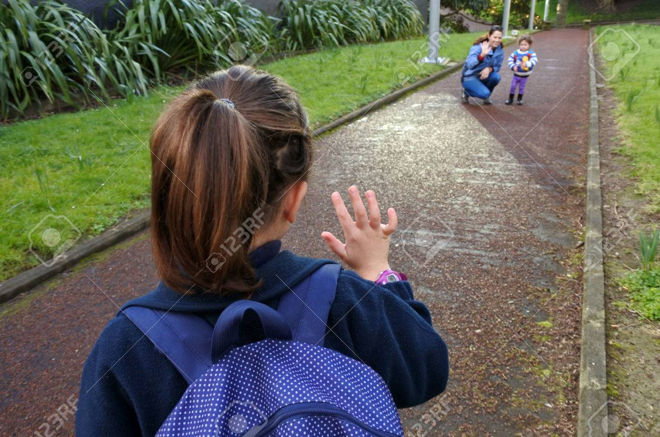 Little girl (age 5-6) going to school wave goodbye to her mother. People education concept - 62201451