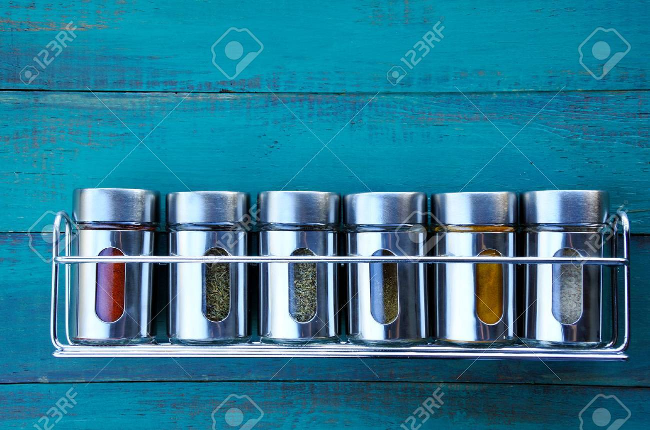 Spice rack on a wooden wall. Food background. copy space - 62201368