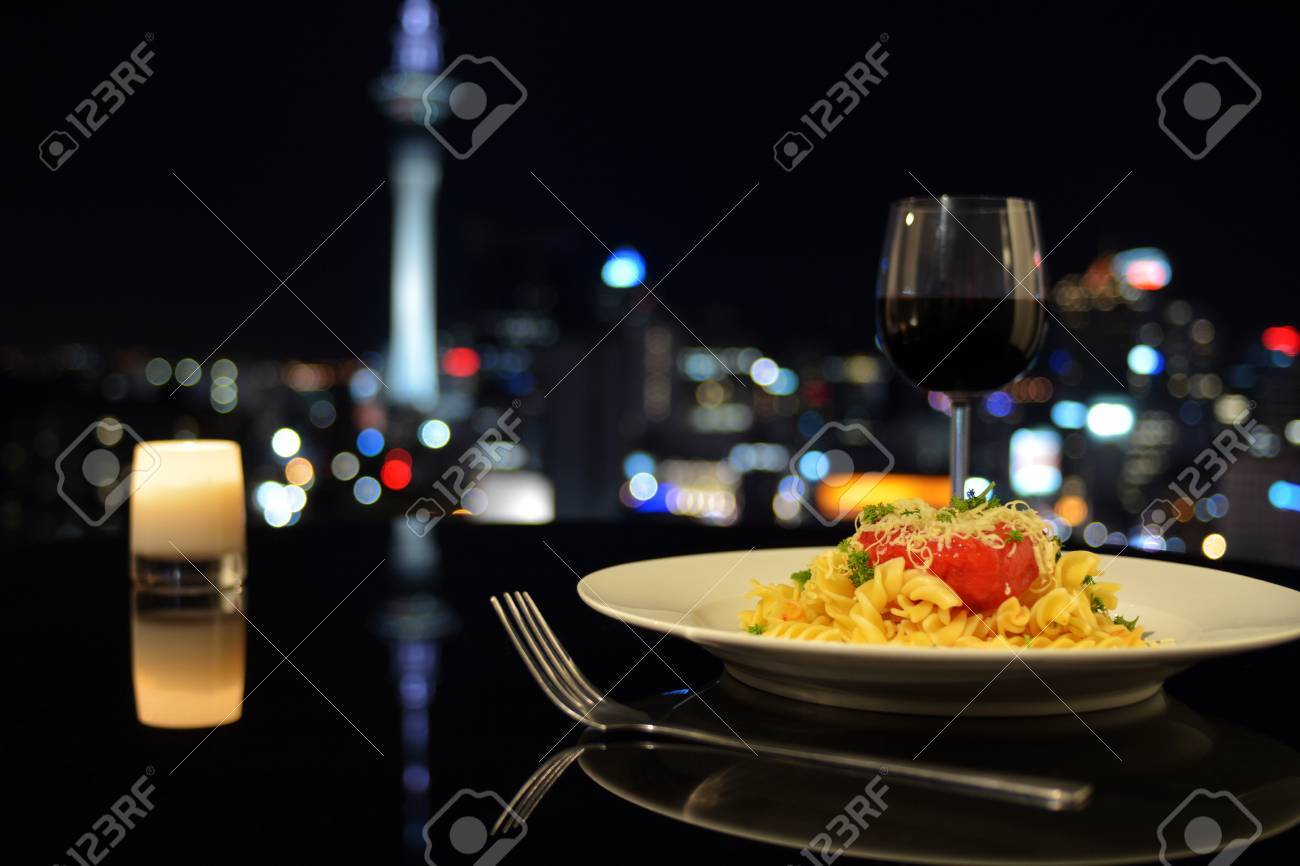Dinner in front of Auckland city skyline at night. City life lifestyle concept. copy space - 62201185