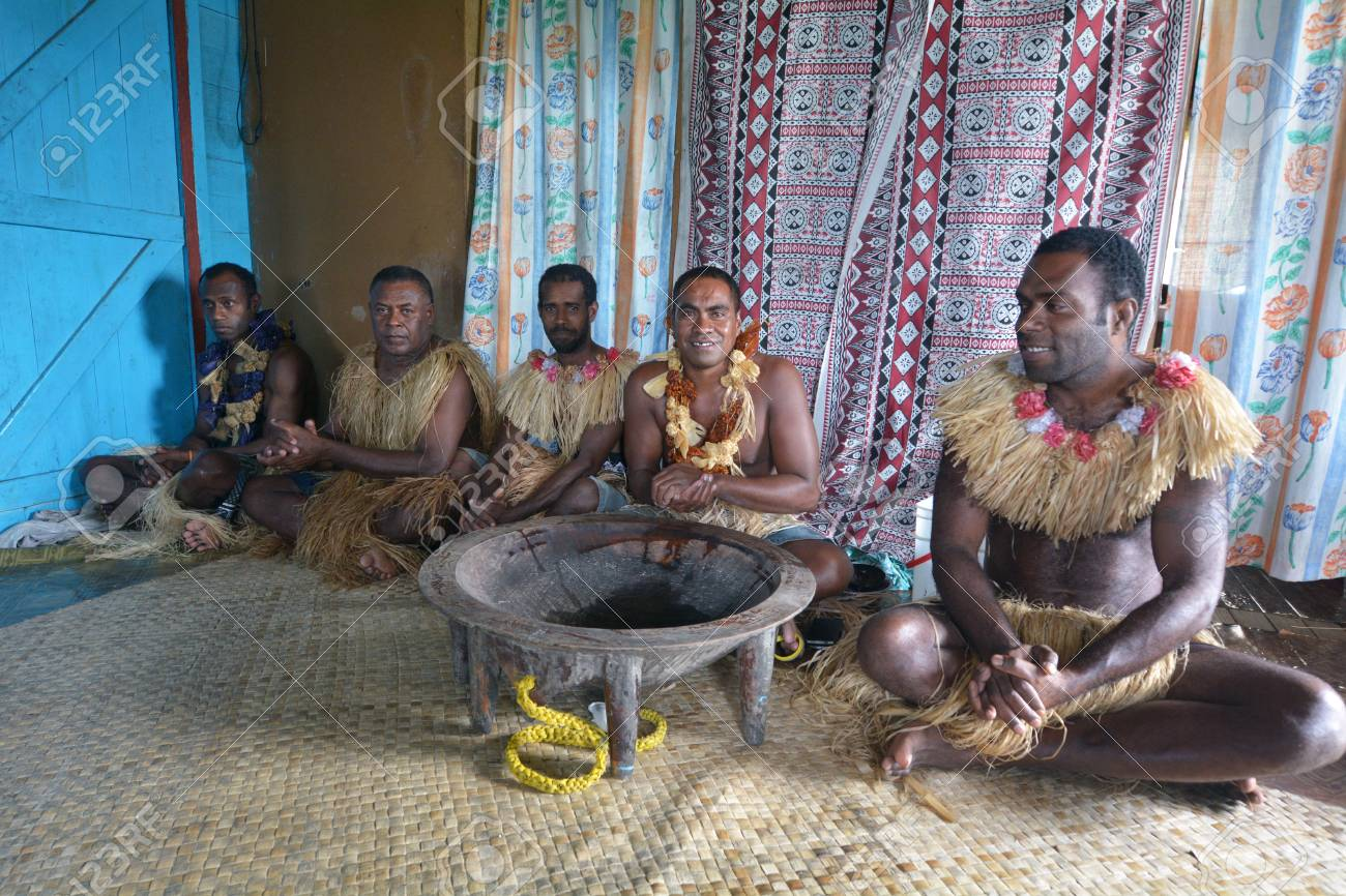 Indigenous Fijians men participate in traditional Kava Ceremony in Fiji. The consumption of the drink is a form of welcome and figures in important socio-political events. - 70725685