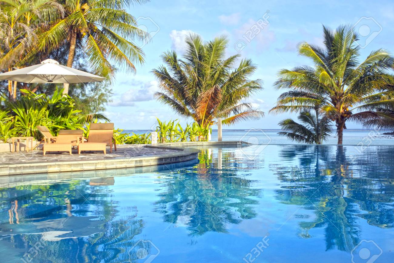 Empty Swimming Pool In A Tropical Island Resort At Sunset In