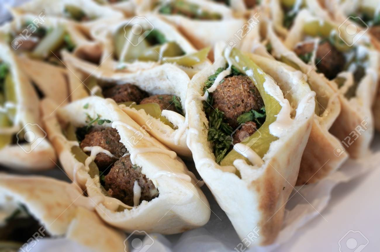 Falafel in pita bread served on a party table. Falafel is a traditional Middle Eastern food. - 115964723