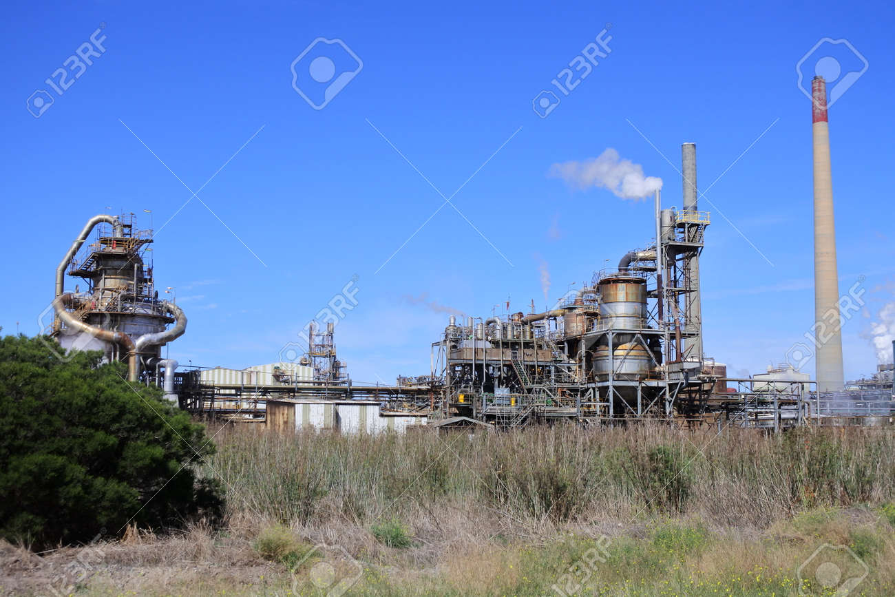 Industrial chimney with smoke against a clear blue sky. Environmental concept.No people. Copy space - 168379569