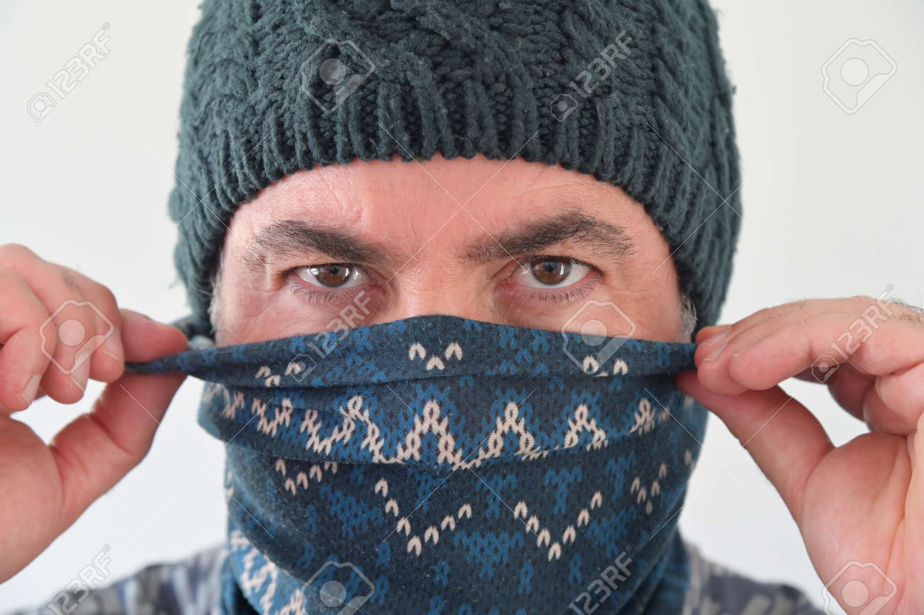 Middle Eastern Militant Man disguising his identity by wearing a beanie and balaclava face cover. - 169904715