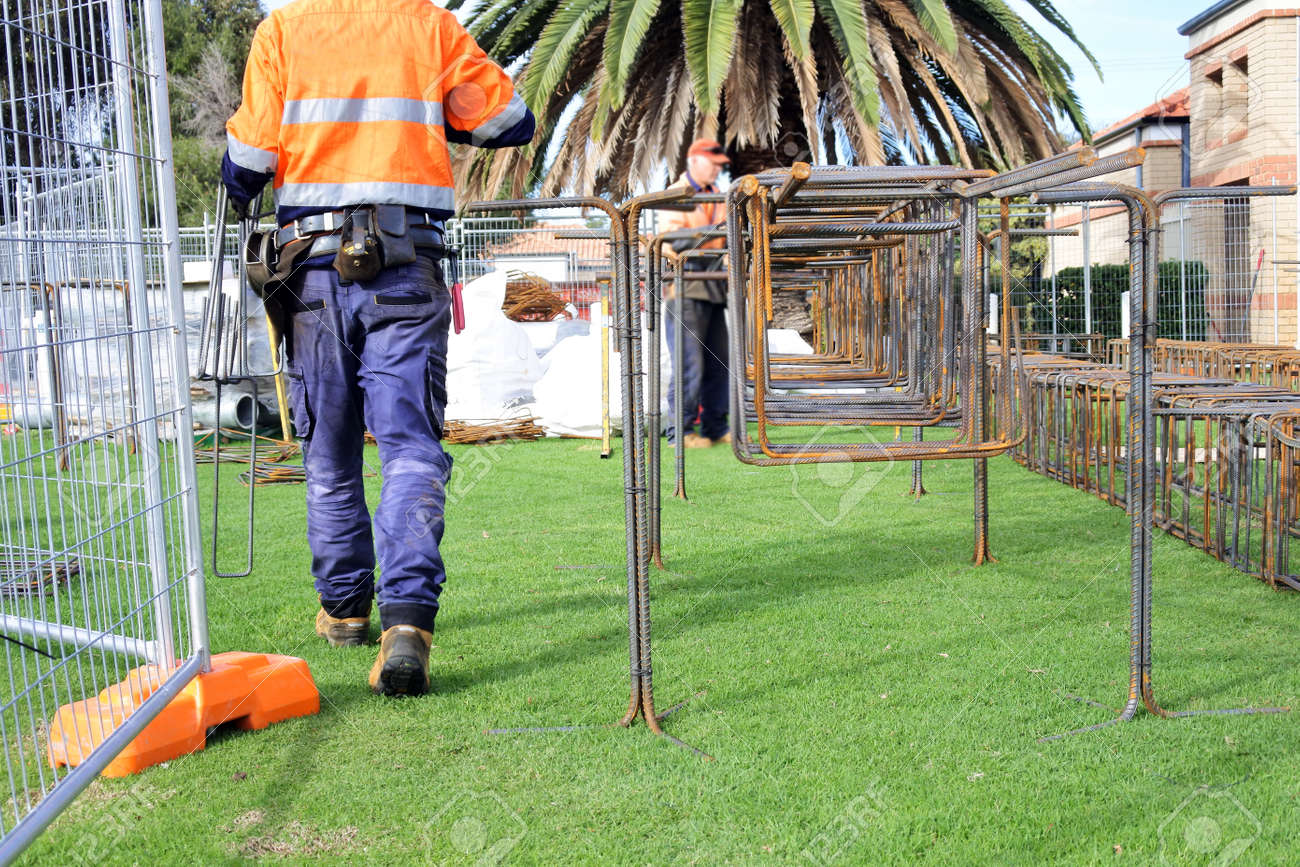 An unrecognizable Australian construction workers working outdoors. - 169904722