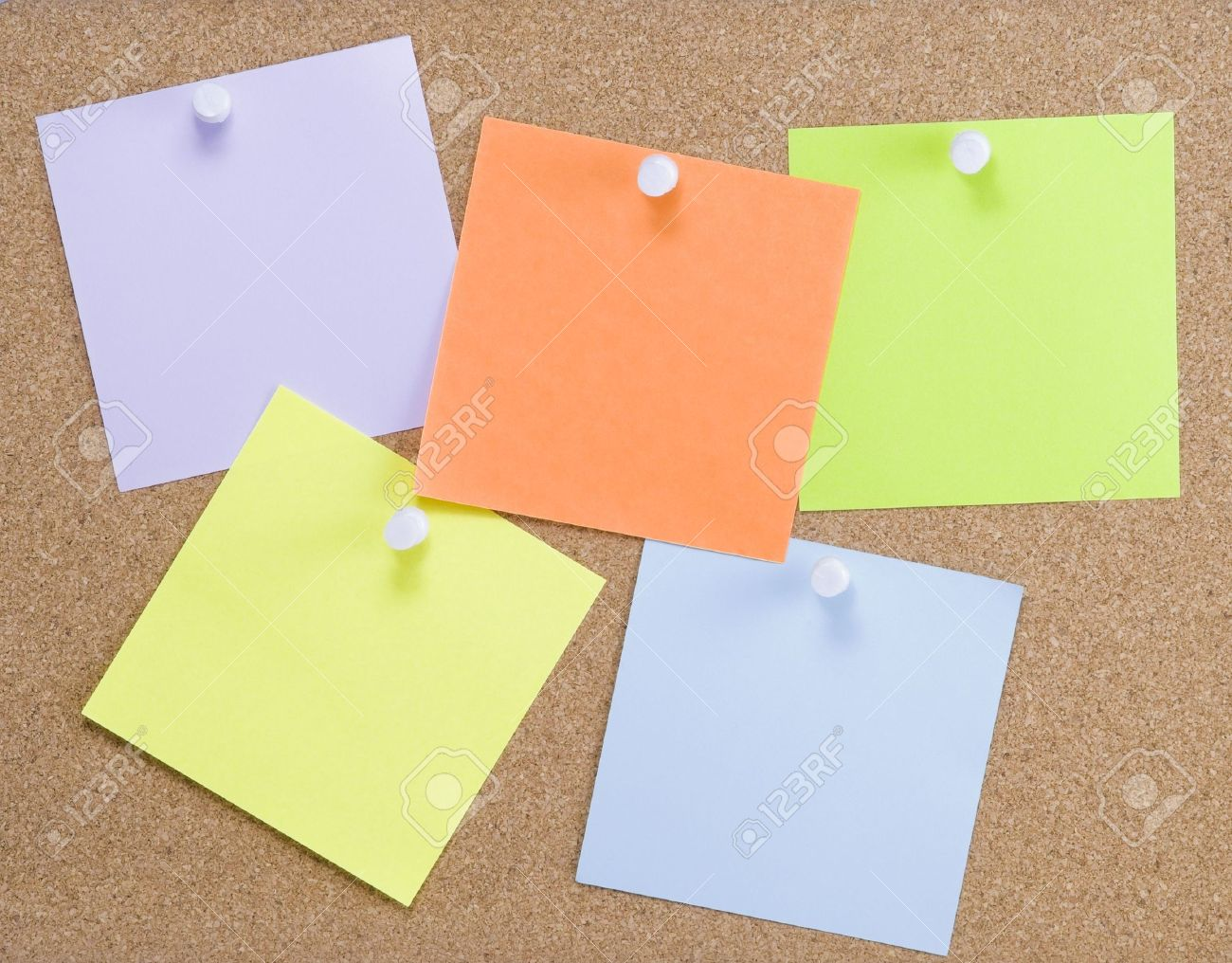 Colorful sticky notes attached to a corkboard with white thumbtacks Stock Photo - 5408860