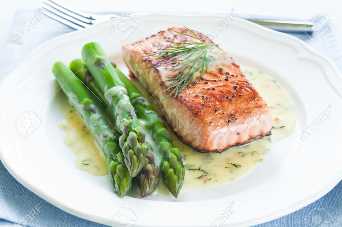 Grilled salmon with asparagus and dill sauce on white plate - 19356934