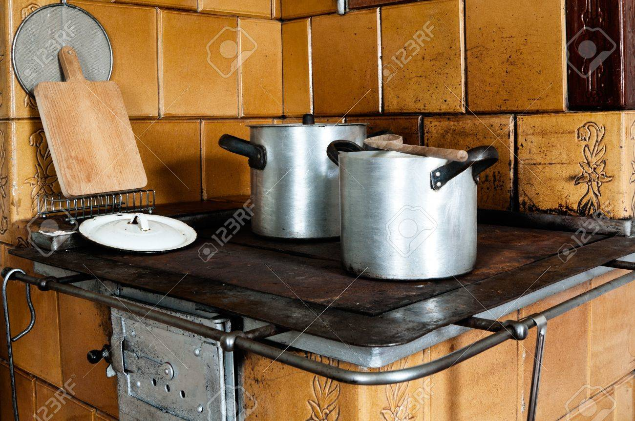 Stock Photo   Vintage Kitchen Stove With Aluminium Pots And Other Utensils