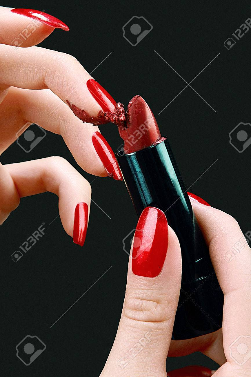 Hands Of A Young Woman With Red Polish Nails Grating Red Lipstick ...