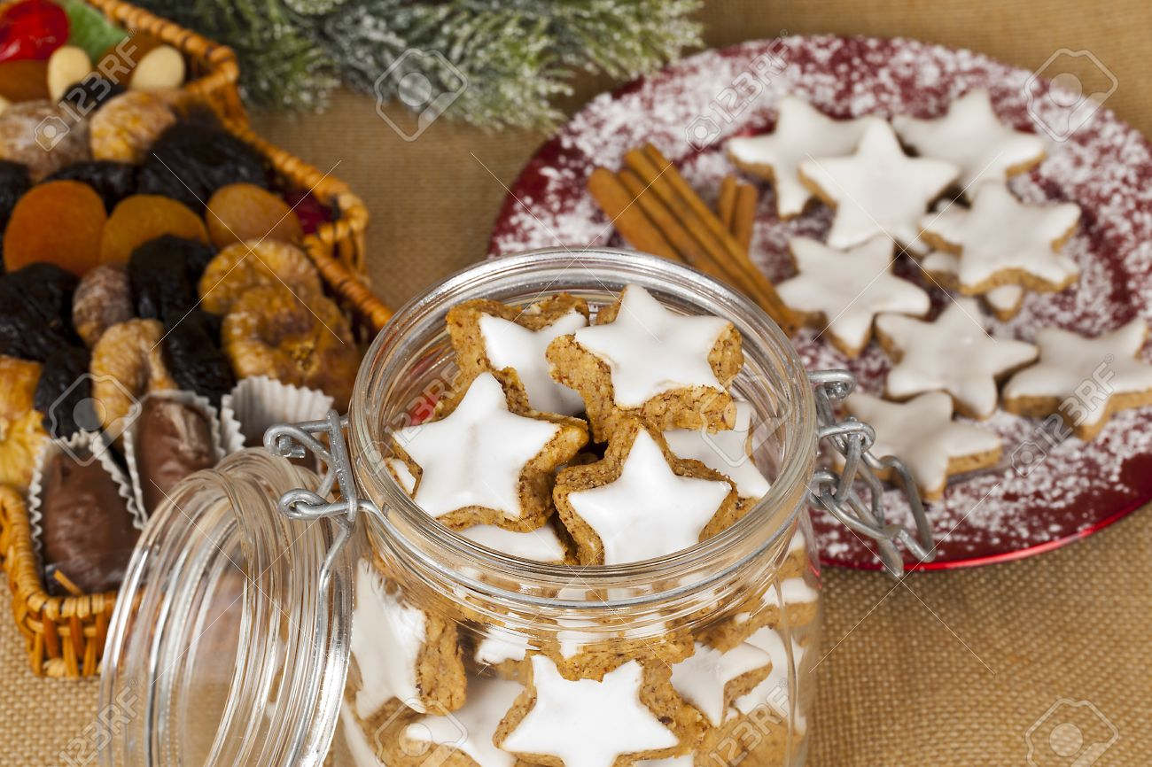 Decorated christmas cookies in jar and on plate