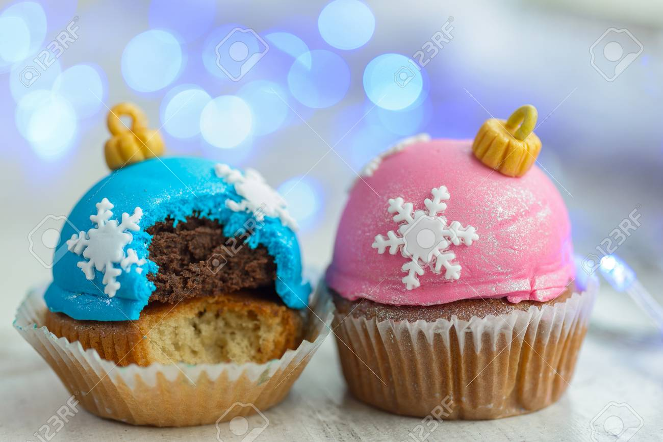 Christmas Themed Cakes Pictures.Two Christmas Decorated Cupcakes On Wooden Windowsill