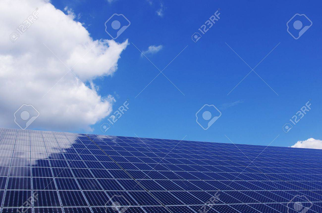 New blue solar panel against blue sky. Some clouds reflecting on the panels. Renewable, clean energy. Stock Photo - 8157235
