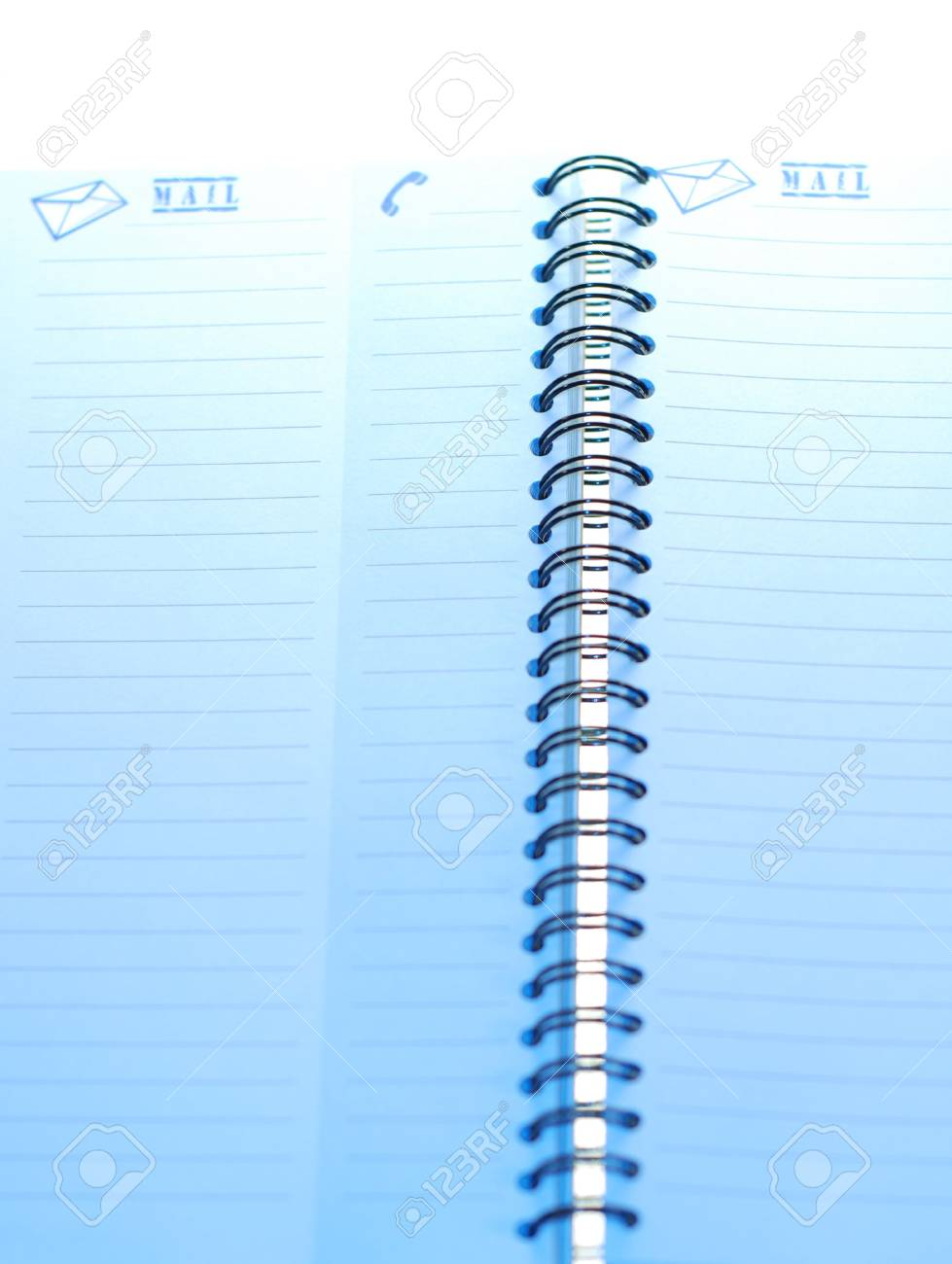 A small spiral notebook being opened ready for use Stock Photo - 2247872