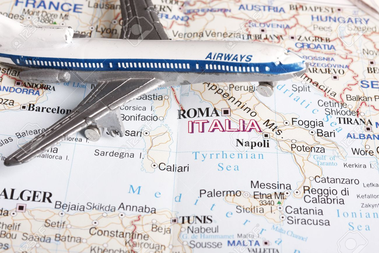 Flight to Italy concept - with toy plane and europe map. Stock Photo - 5891636