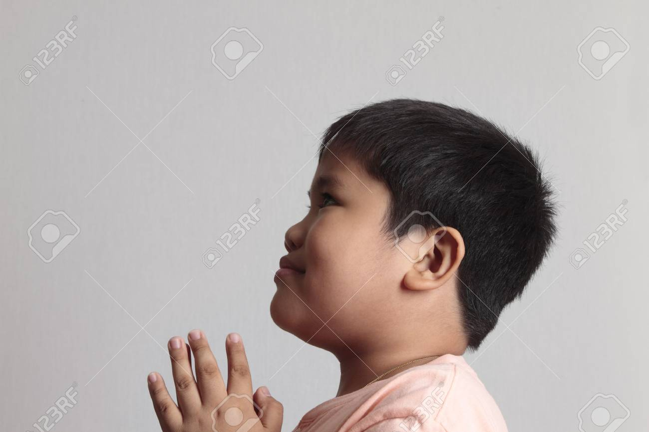 Child pray over gray background. Beauty image Stock Photo - 7479091