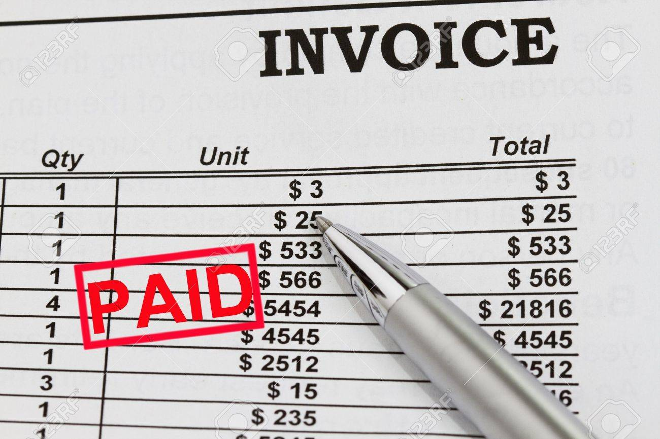 paid invoices abstract with pen and dollar billing schedule stock