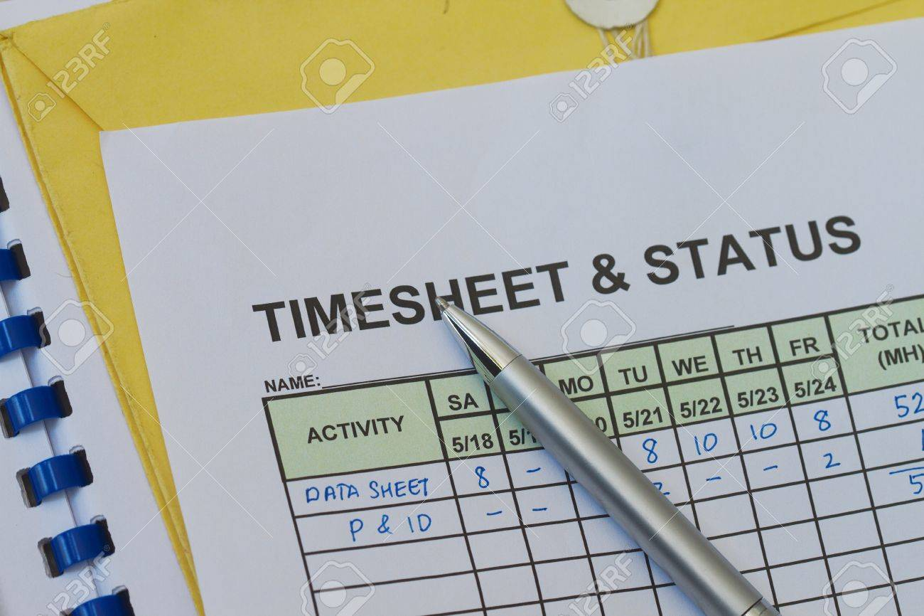weekly timesheet with pen timekeeping record and payroll stock