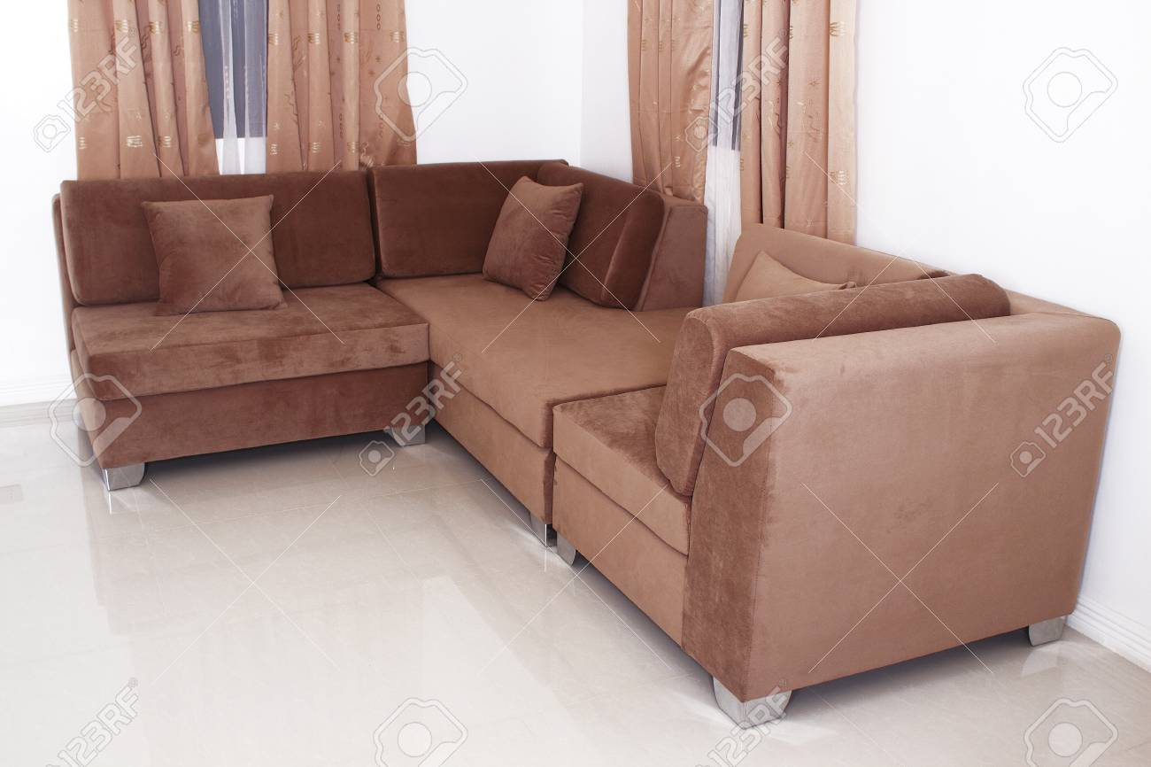 L Shape Sofa Furniture Luxurious With Pillows In White Wall Paint