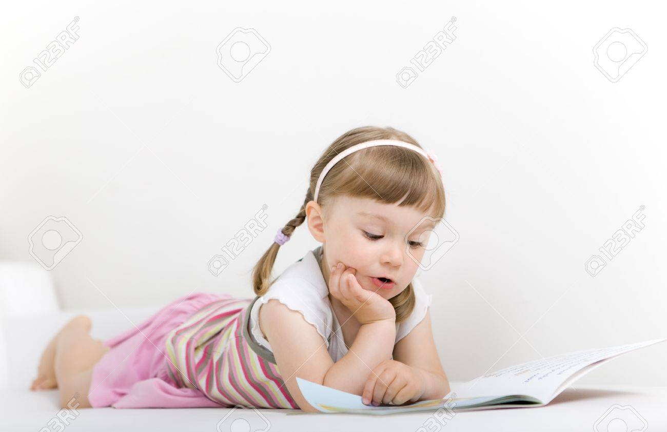 sweet happy little girl reading book Stock Photo - 7284451