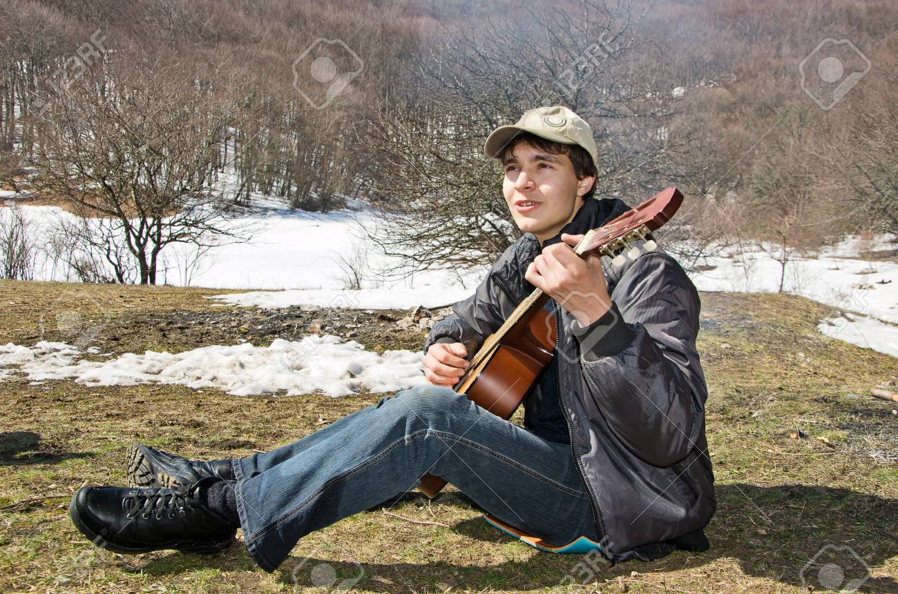 guitarist playing in spring picnic Stock Photo - 12941395