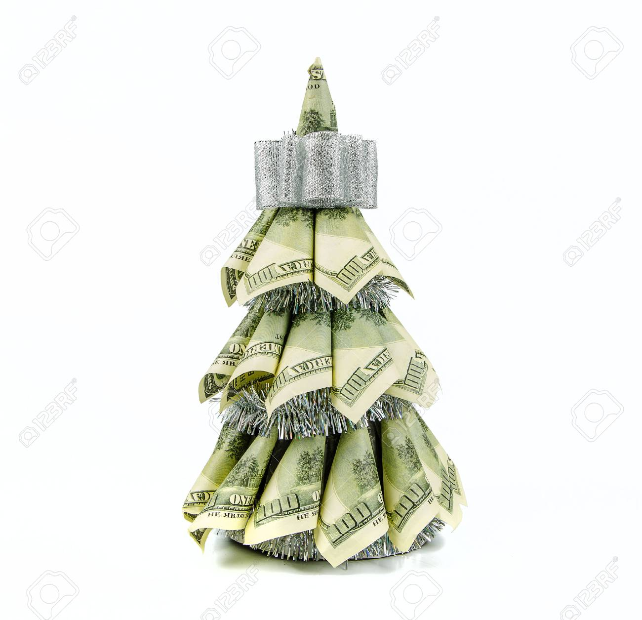christmas tree by dollars on white background stock photo