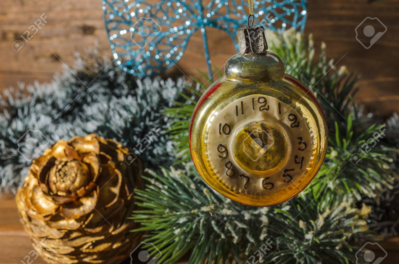 retro clock with old fashioned christmas tree decorations stock photo 90091754