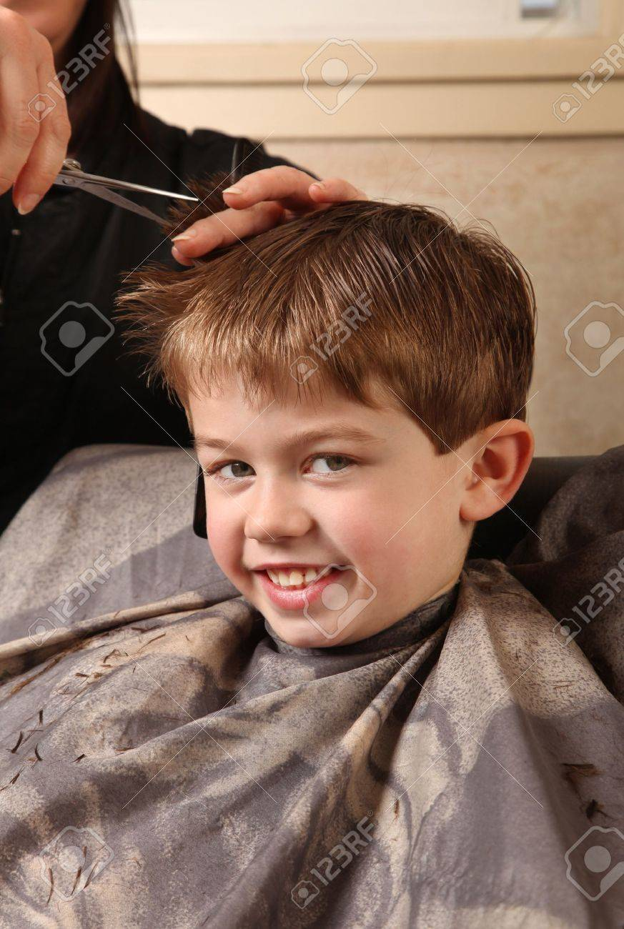 Cute Young Boy Getting A Haircut Stock Photo