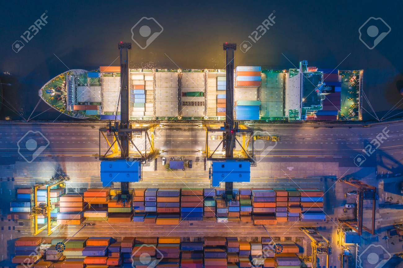 Aerial top view of ship containers at shipping port for international
